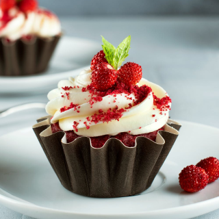 a photo of a cupcake with berries