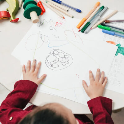 a child colors pictures
