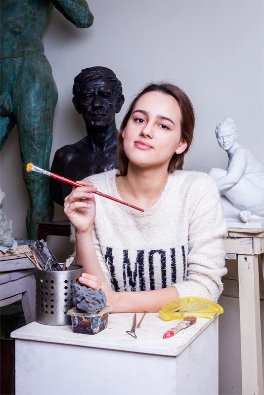 Artist with a brush in her hand