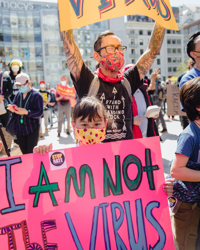 Child with I am not a virus sign
