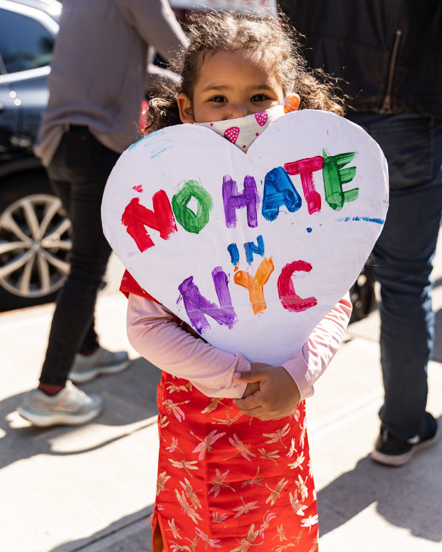 Child with no hate in NYC sign